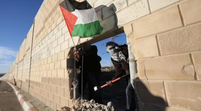 Palestinians break open illegal apartheid wall 25 years after Berlin Wall fall