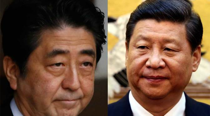 Xi, Abe meet as big-power rivalries take APEC stage
