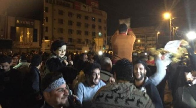 Iraqis celebrate end of curfew in Baghdad