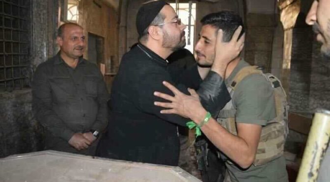 Welcome To Iraq's Liberated Bartella: Assyrian Priest Kisses Shi'a Muslim Soldier In Thanks