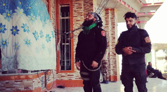 Iraqi Shi'a Legend Abou Azrael Prays With A Sunni Fighter Near Mosul, Demolishing Zionist Media's Sectarian Narrative