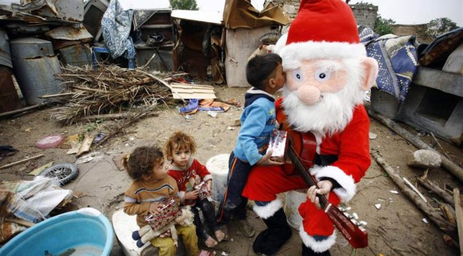 In Iraq's Wartorn, Poverty-Stricken Najaf, An Iraqi Santa Claus Brings Joy To Children On Christmas